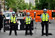 Montreal police stand guard at a barricade outside a reception for the Canada Grand Prix Formula One race participants, on June 7. Student demonstrators had gathered at the site to protest the race