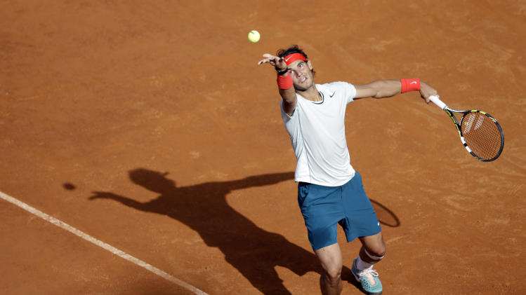 Spain's Rafael Nadal serves the ball to Czech Republic's Tomas Berdych during their semi final match at the Italian Open tennis tournament in Rome, Saturday, May 18, 2013. Nadal won 6-2, 6-4. (AP Photo/Andrew Medichini)