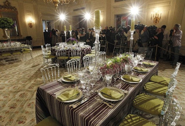 Table settings in the State Dining Room of the White House in Washington, Wednesday, March 14, 2012, ahead of tonight&#39;s State Dinner hosted by President Barack Obama and first lady Michelle Obama for British Prime Minister David Cameron and his wife Samantha. (AP Photo/Pablo Martinez Monsivais)