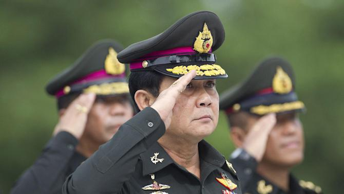 Thailand's new Prime Minister Prayuth Chan-ocha salutes during an establishment anniversary of the 21st infantry regiment, Queen's Guard, in Chonburi Province, Thailand, Thursday, Aug. 21, 2014. Three months after overthrowing Thailand's last elected government, this Southeast Asian nation's junta leader is stepping out of his army uniform for good - to take up the post of prime minister in a move critics say will only extend his time at the helm and consolidate the military's grip on power. (AP Photo/Sakchai Lalit)