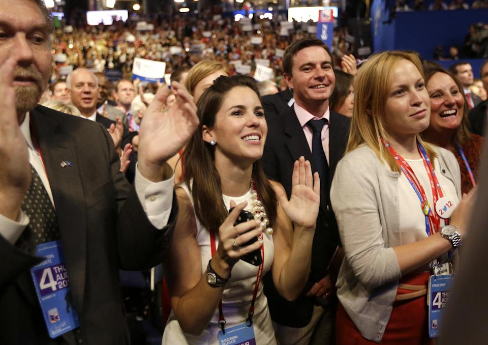 Delegates react as Republican presidential nominee Mitt Romney addresses delegates before speaking at the Republican National Convention in Tampa, Fla., on Thursday, Aug. 30, 2012.  (AP Photo/David Goldman)
