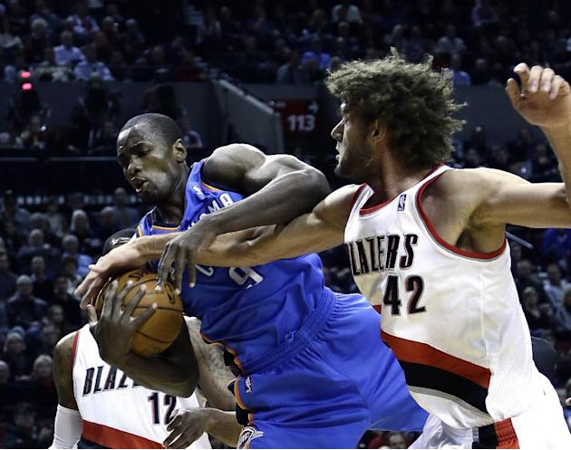 Oklahoma City Thunder forward Serge Ibaka, left, from the Republic of Congo, battles for the ball with Portland Trail Blazers center Robin Lopez during the first half of an NBA basketball game in Port