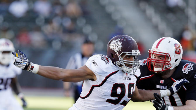 IMAGE DISTRIBUTED BY AP IMAGES FOR NFLPA- The National team offensive lineman Ronald Mattes (60) of North Carolina States tries to stop American team defensive end Shane McCardell (99) of Mississippi State during the NFLPA Collegiate Bowl on Saturday, Jan. 19, 2013 in Carson, Calif. (Ric Tapia/AP Images for NFLPA)