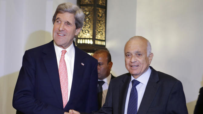 In this March 2, 2013, photo, U.S. Secretary of State John Kerry, left, poses for a photograph with Arab League Secretary General Nabil Elaraby, after their meeting in Cairo, Egypt. With the smile of a seasoned politician, a flair for languages and a vast repertoire of personal anecdotes, Kerry schmoozed and cajoled his way through Europe and the Middle East on his first trip abroad as America's top envoy over the past 10 days. (AP Photo/Jacquelyn Martin, Pool)