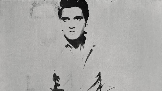 """FILE - This undated image provided by Sotheby's shows Andy Warhol's portrait of Elvis Presley depicted as a cowboy. The painting, with a silver background, """"Double Elvis [Ferus Type]"""" is estimated to sell for between $30 million to $50 million at Sotheby's in New York on Wednesday May 9, 2012. (AP Photo/Sotheby's, File)"""