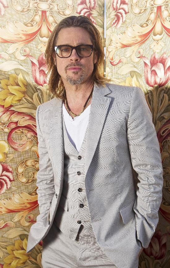 "FILE - This May 23, 2012 file photo shows actor Brad Pitt posing for portraits during the 65th Cannes Film Festival in Cannes, France. Pitt has agreed to donate $100,000 to help the Human Rights Campaign raise money for its efforts to support same-sex marriage initiatives in several states.The nation's largest gay rights group announced Wednesday, Oct. 31, that Pitt agreed to match contributions from the group's members up to $100,000. In an e-mail to members of the Human Rights Campaign, Pitt wrote that it's ""unbelievable"" that people's relationships will be put to a vote on Election Day. (AP Photo/Joel Ryan, file)"