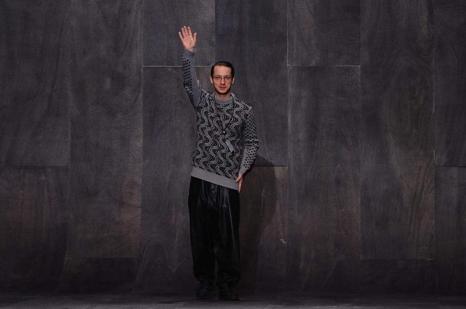 Fashion designer Damir Doma greats the audience at the end of his fall-winter 2013/2014 men's fashion collection, in Paris, Saturday, Jan. 19, 2013. (AP Photo/Zacharie Scheurer)
