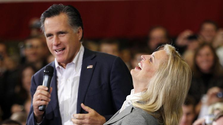 FILE - In this March 5, 2012, file photo, Ann Romney, wife of Republican presidential candidate, former Massachusetts Gov. Mitt Romney, laughs with him as he campaigns at a town hall meeting at Taylor Winfield in Youngstown, Ohio. Long before Romney became the millionaire candidate from Massachusetts, he was his father' son, weeding the garden in the upscale suburb of Detroit where he grew up. He hated the chore. But he idolized the man who made him do it _ George Romney, the outspoken, no-nonsense, auto executive turned politician. (AP Photo/Gerald Herbert, File)
