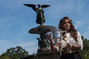 Williams of the U.S. poses with her trophy after winning the women's singles final match at the U.S. Open tennis tournament in New York