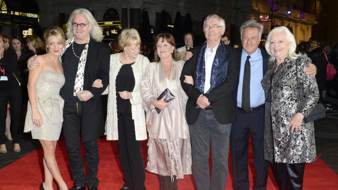 """FILE - In this Oct. 15, 2012 file photo, from left, Sheridan Smith, Billy Connolly, Dame Maggie Smith, Pauline Collins, Tom Courtenay, Dustin Hoffman and Dame Gwyneth Jones pose at the London Film Festival American Airlines Gala -Quartet at Odeon West End, in London. The 75-year-old Hoffman went behind the camera for """"Quartet,"""" starring Smith, Courtenay, Connolly and Collins as aging British opera divas at a retirement home for musicians who put aside past differences for a reunion concert. (Photo by Jon Furniss/Invision, File)"""