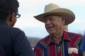 """Rancher Cliven Bundy greets a supporter during a Bundy family """"Patriot Party"""" near Bunkerville, Nevada"""