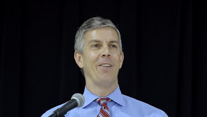 """This photo taken Nov. 7, 2013 shows Education Secretary Arne Duncan speaking Malcolm X Elementary School in Washington. Duncan continued to face criticism Monday over reported remarks that seemed to dismiss """"white suburban moms"""" for opposing higher academic standards. Duncan has consistently shown little patience for critics of the Common Core State Standards, being implemented in 45 states and the District of Columbia. But his remarks, as reported by Politico, went a step further and add elements of race and class. (AP Photo/Susan Walsh)"""