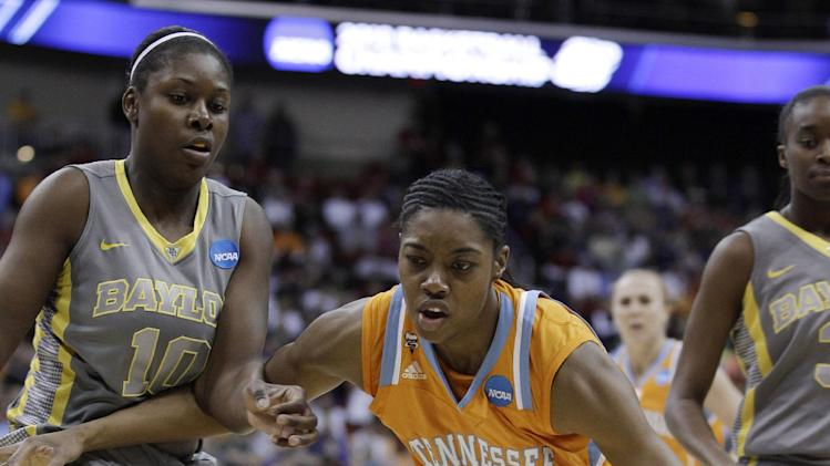 Tennessee's Vicki Baugh looks to drive past Baylor forward Destiny Williams, left, during the first half of an NCAA women's college basketball tournament regional final, Monday, March 26, 2012, in Des Moines, Iowa. (AP Photo/Charlie Neibergall)
