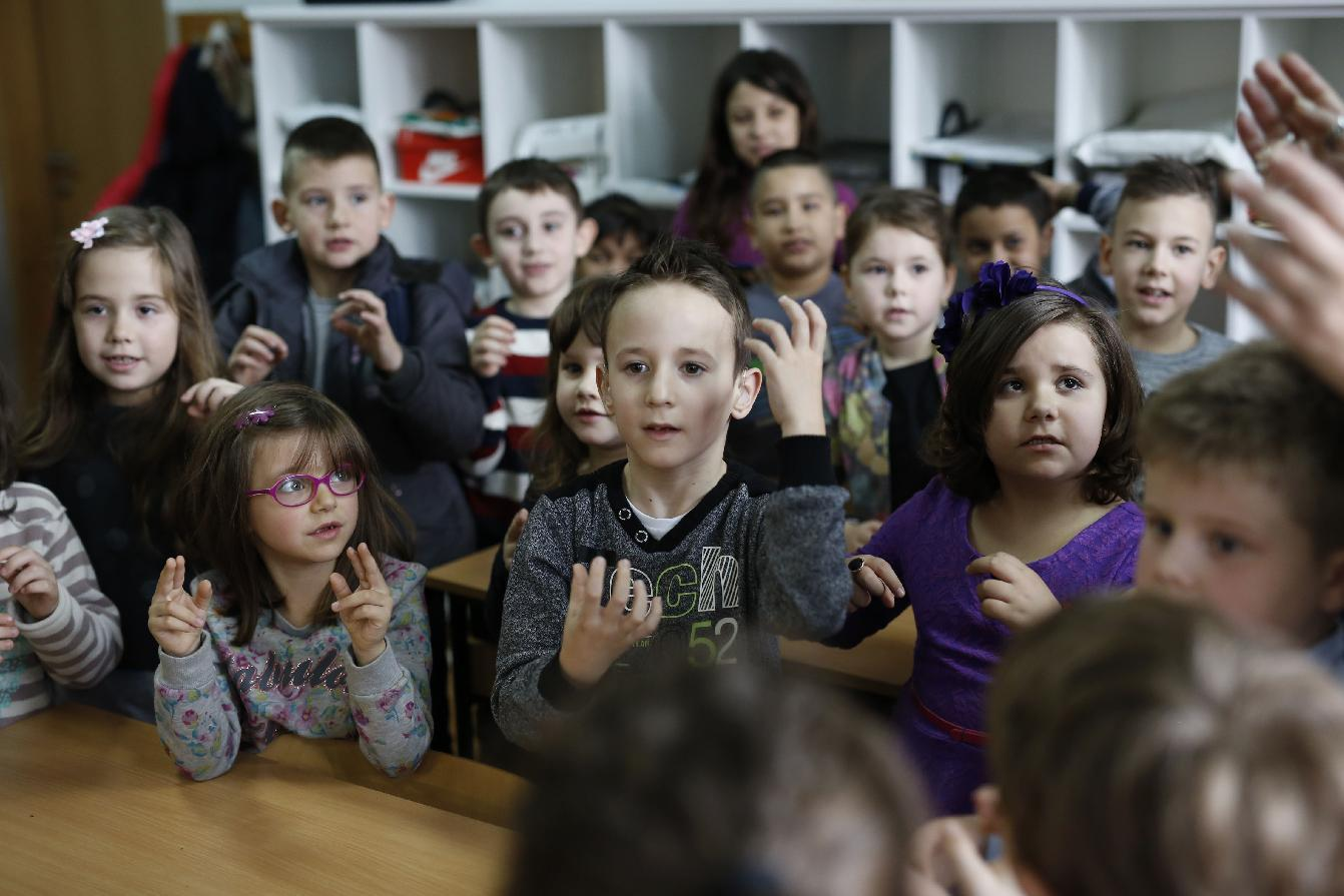 Bosnian first-graders reach out to deaf schoolmate