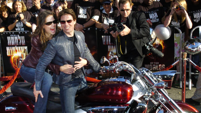 """FILE - In this June 27, 2005 file photo, Tom Cruise, star of the new film """"War of the Worlds,"""" arrives with his fiancee Katie Holmes on motorcycle for a screening of the film at Grauman's Chinese Theatre in Los Angeles. Cruise and Homes are calling it quits after five years of marriage. Holmes' attorney Jonathan Wolfe said Friday June 29, 2012 that the couple is divorcing, but called it a private matter for the family. (AP Photo/Chris Pizzello, File)"""