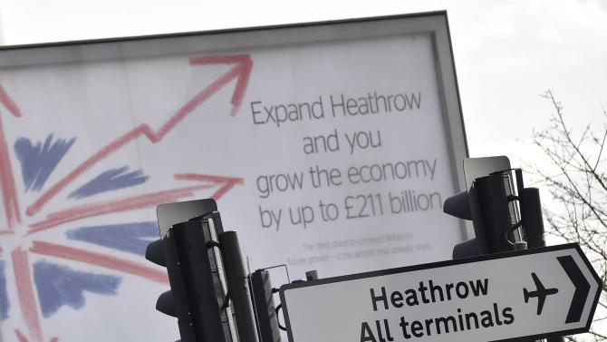 An advertisement poster promoting Heathrow airport is seen on the boundary of the airport, west London