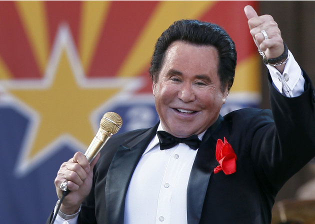 FILE - In this Feb. 14, 2012 file photo, Entertainer Wayne Newton performs during the 100th Anniversary celebration of Arizona's statehood, at the Capitol in Phoenix. The company that purchased the ri