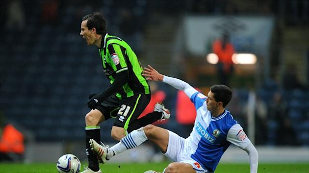 David Lopez, left, scored a late penalty as Brighton drew with Blackburn