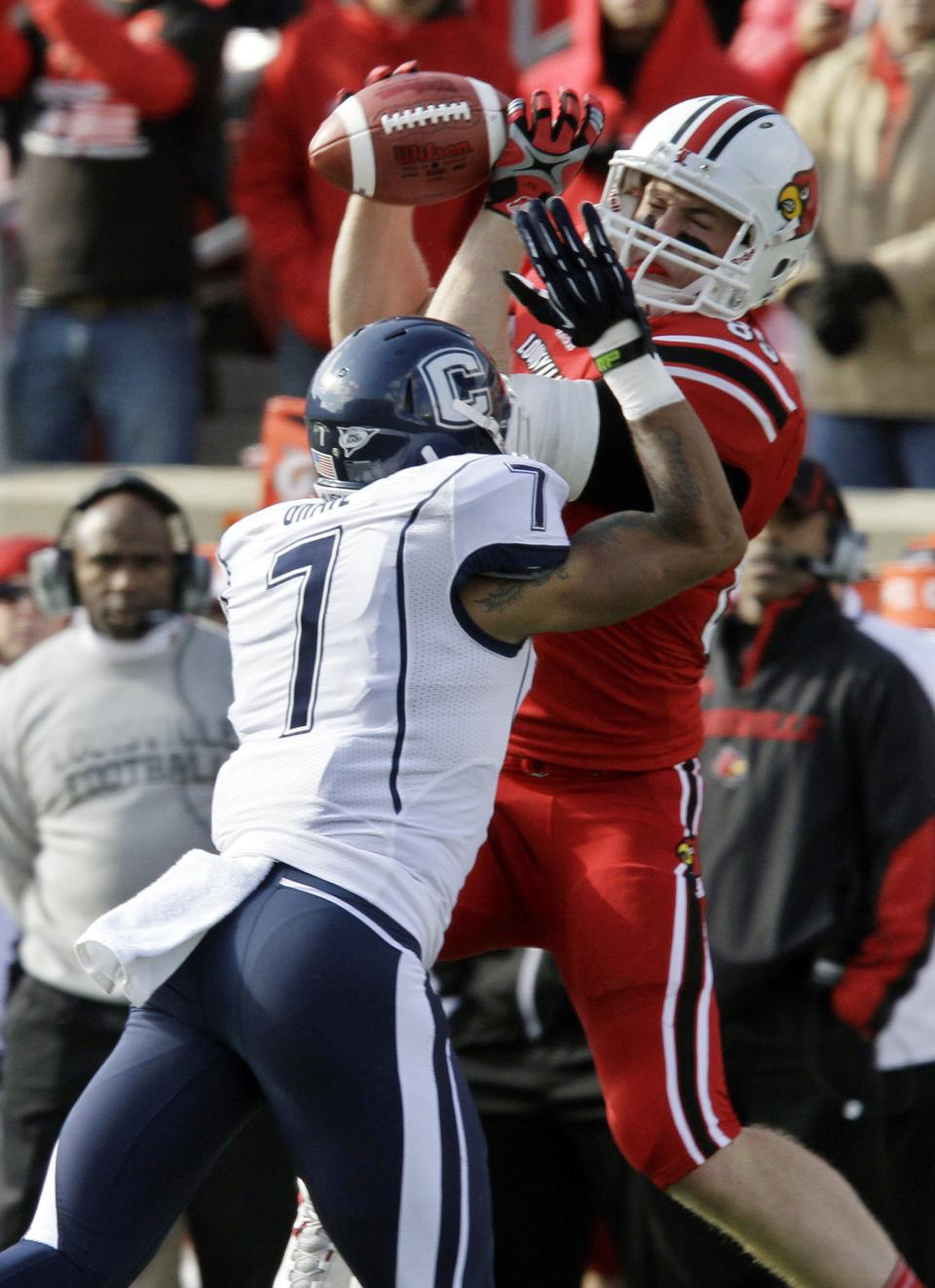 Louisville tight end Ryan Hubbell (83) cannot gather in a pass as Connecticut's Dwayne Gratz (7) breaks up the play during the first half of an NCAA college football game in Louisville, Ky., Saturday, Nov. 24, 2012.  (AP Photo/Garry Jones)