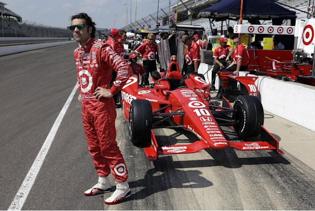 Dario Franchitti, of Scotland, waits next to his car during a break in a practice session on the second day of qualifications for the Indianapolis 500 auto race at the Indianapolis Motor Speedway in I