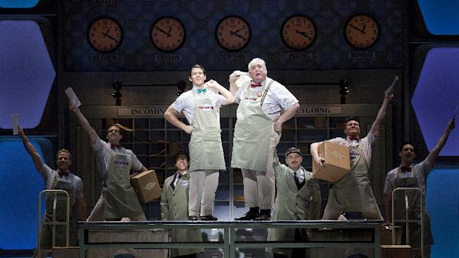 "In this undated publicity image released by The Hartman Group, Nick Jonas and Rob Bartlett perform in a scene from ""How to Succeed in Business Without Really Trying"" at the Al Hirschfeld Theatre in New York. Jonas tried hard but couldn't keep Broadway's ""How to Succeed in Business Without Really Trying"" in business. Producers of the musical said Tuesday they they were reluctantly handing it a pink slip after several months of lackluster box office revenue. Its final performance will be May 20. (AP Photo/The Hartman Group, Joan Marcus)"