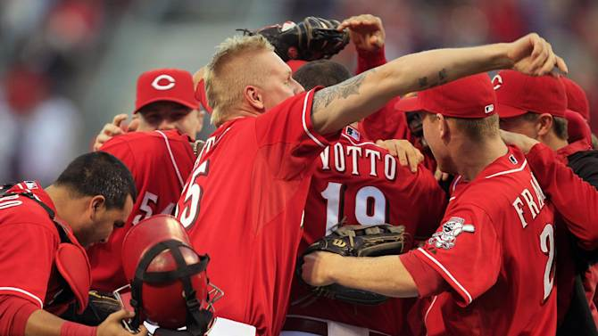 Cincinnati Reds starting pitcher Mat Latos (55) celebrates with teammates after they defeated the Los Angeles Dodgers 6-0 to clinch the National League Central Division in a baseball game on Saturday, Sept. 22, 2012, in Cincinnati. (AP Photo/Al Behrman)