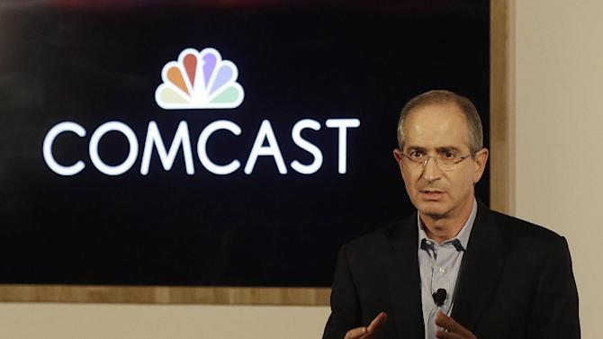 FILE - In this Nov. 12, 2014 file photo, Comcast Corp. Chairman & CEO Brian Roberts speaks during a presentation at the Contemporary Jewish Museum in San Francisco. Comcast Corp. reports quarterly financial results on Monday, May 4, 2015. (AP Photo/Jeff Chiu, File)