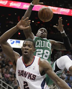 Boston Celtics' Mickael Pietrus, rear, grabs a rebound away from Atlanta Hawks' Joe Johnson during the second quarter of Game 1 of an opening-round NBA basketball playoff series, Sunday, April 29, 2012, in Atlanta. (AP Photo/David Goldman)