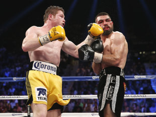 Canelo Alvarez (L) would be a great match for Gennady Golovkin, but television affiliations will likely prevent it from occurring. (AP Photo/Eric Jami...