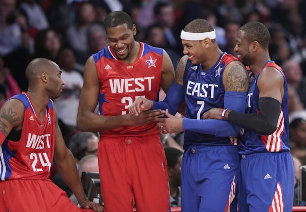 From left, West Team's Kobe Bryant, Kevin Durant, East Team's Carmelo Anthony and Dwyane Wade laugh during the first half of the NBA All-Star basketball game Sunday, Feb. 17, 2013, in Houston.