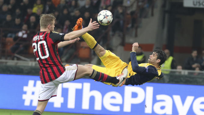 Atletico Madrid Brazilian forward Diego Costa tries an acrobatic shot as AC Milan defender Ignazio Abate tries to stop him during a Champions League, round of 16, first leg, soccer match between AC Milan and Atletico Madrid at the San Siro stadium in Milan, Italy, Wednesday, Feb. 19, 2014