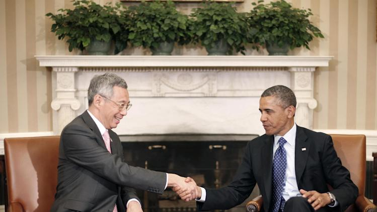 President Barack Obama shakes hands with with Singapore Prime Minister Lee Hsien Loong during their meeting in the Oval Office of the White House in Washington, Tuesday, April, 2, 2013.  (AP Photo/Pablo Martinez Monsivais)