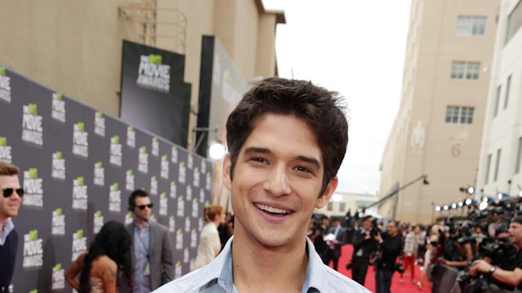Tyler Posey arrives at the MTV Movie Awards in Sony Pictures Studio Lot in Culver City, Calif., on Sunday April 14, 2013.  (Photo by Eric Charbonneau/Invision for MTV/AP Images)