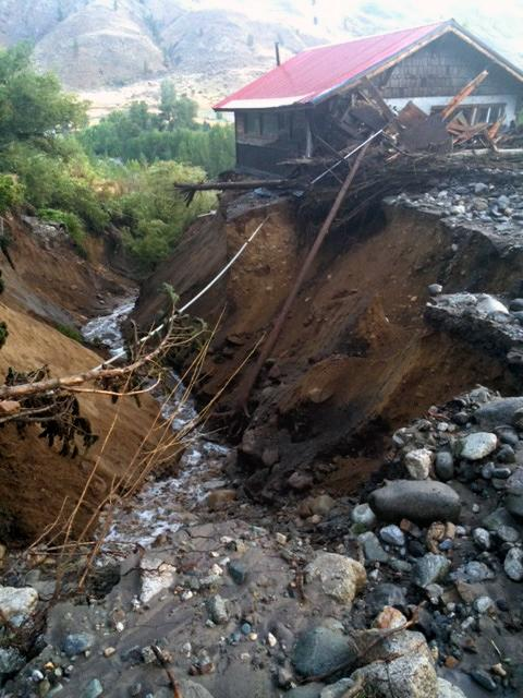 This image made from a video provided by KOMO News shows north central Washington after rain created mudslides on Friday, Aug. 22, 2014. The land, which was left bare by wildfires, washed down hillsides, damaged homes and closed highways. (AP Photo/KOMO News) SEATTLE OUT
