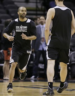 Tony Parker participated in drills at half speed the day before the start of the NBA Finals. (AP)