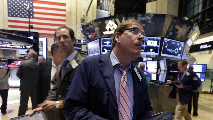 In this Tuesday, Aug. 13, 2013, photo, traders work on the floor of the New York Stock Exchange. Good news from two of Europe's biggest economies failed to shake global stock markets out of their lethargy Wednesday Aug. 14, 2013. (AP Photo/Richard Drew)