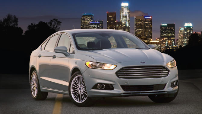 This undated image provided by Ford shows the 2013 Ford Fusion Hybrid. (AP Photo/Ford)