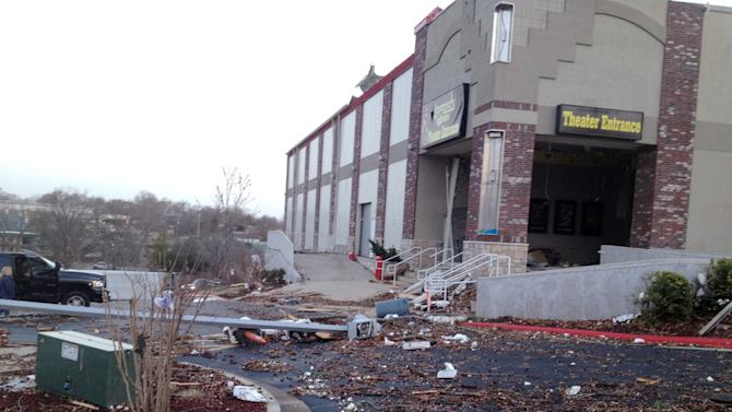 Debris is scattered around the Legends Theater Wednesday, Feb. 29, 2012, in Branson, Mo., after an apparent tornado left a trail of destruction in the tourist hub. A powerful storm system that produced multiple reports of tornadoes lashed the Midwest early Wednesday, roughing up the country music resort city of Branson. (AP Photo/The News-Leader, Valerie Mosley)  NO SALES