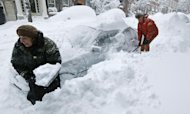 Deb Hanley, left, and Frank McGuire dig about three feet of snow from around their car outside their home in the Beacon Hill neighborhood of Boston, Saturday, Feb. 9, 2013. The Boston area received about two feet of snow from a winter storm. A howling storm across the Northeast left the New York-to-Boston corridor shrouded in 1 to 3 feet of snow Saturday, stranding motorists on highways overnight and piling up drifts so high that some homeowners couldn&#39;t get their doors open. More than 650,000 homes and businesses were left without electricity. (AP Photo/Charles Krupa)