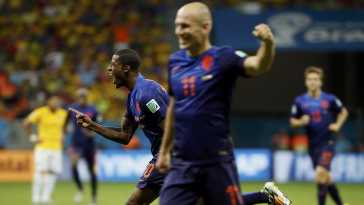Wijnaldum of the Netherlands celebrates after scoring against Brazil during their 2014 World Cup third-place playoff at the Brasilia national stadium in Brasilia
