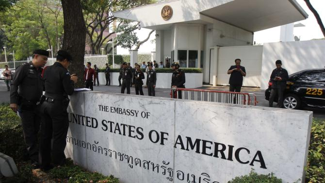 Police stand guard outside the U.S. embassy in Bangkok