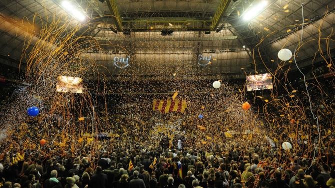 Supporters celebrate at a meeting of leader of the Catalan Convergence and Unity party (CIU) Artur Mas, candidate for president of the Catalunya regional government, in Barcelona, Spain, Friday, Nov. 26, 2010. In Catalonia's elections, many see the beginning of the end of the Socialists' grip on power in Spain. (AP Photo/Manu Fernandez)