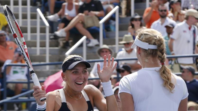 Vesnina and Ekaterina Makarova of Russia celebrate after defeating Venus and Serena Williams of the U.S. in their quarter-final doubles match at the 2014 U.S. Open tennis tournament in New York