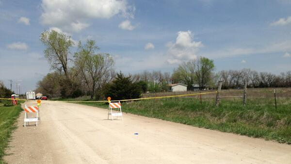"""The area surrounding a farm in rural Ottawa, Kan., is blocked off by police tape Tuesday May 7, 2013, after three bodies were found there Monday.  The bodies of two adult men and one woman were found Monday on the farm.  Sheriff Jeff Richards said """"We have three homicides on a very large scene.""""  (AP Photo/The Topeka Capital Journal, Aly Van Dyke)"""