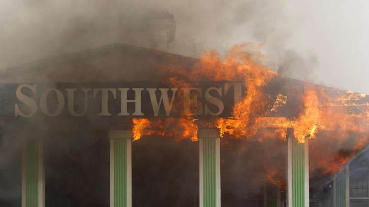 Flames erupt from the Southwest Inn on U.S. 59 in Houston on Friday, May 31, 2013. (AP Photo/Houston Chronicle, Cody Duty)