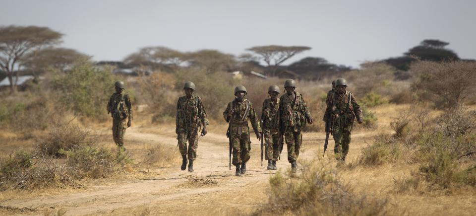 Kenyan army soldiers patrol near their base in Tabda, inside Somalia Monday, Feb. 20, 2012. Kenya's military has been fighting inside Somalia in an ongoing offensive against militant group al-Shabab since October, when Somali gunmen carried out several kidnappings in Kenya. (AP Photo/Ben Curtis)