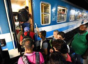Migrants at Zagreb's main railway station board…