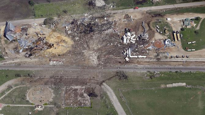"""This April 18, 2013 aerial photo shows a destroyed fertilizer plant, top, following an explosion in West, Texas.  The Federal Emergency Management Agency is refusing to provide money to help rebuild West, the small Texas town where a deadly fertilizer plant explosion leveled numerous homes and a school, and killed 15 people.  According to a letter obtained by The Associated Press, FEMA said it reviewed the state's appeal to help West but decided that the explosion """"is not of the severity and magnitude that warrants a major disaster declaration."""" FEMA has, however, provided emergency funds to individual residents.  (AP Photo/Tony Gutierrez)"""