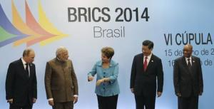 Russian President Putin, Indian Prime Minister Modi, Brazilian President Rousseff, Chinese President Xi and South African President Zuma talk at a group photo session during the 6th BRICS summit in Fortaleza