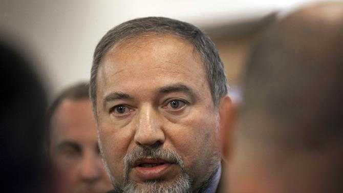 Israeli Foreign Minister Avigdor Lieberman arrives at the weekly cabinet meeting in Jerusalem, Sunday, Jan. 8, 2012. (AP Photo/Menahem Kahana, Pool)